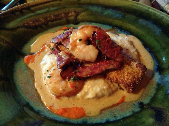 Trout atop shrimp and grits